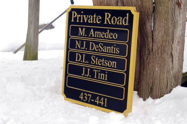 Multiple name entrance sign custom made painted black and gold