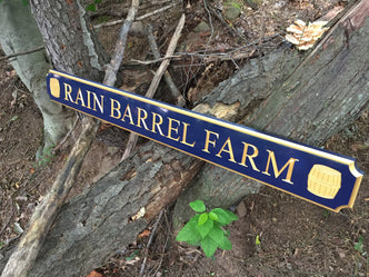 custom quarterboard with rain barrels painted navy blue and gold