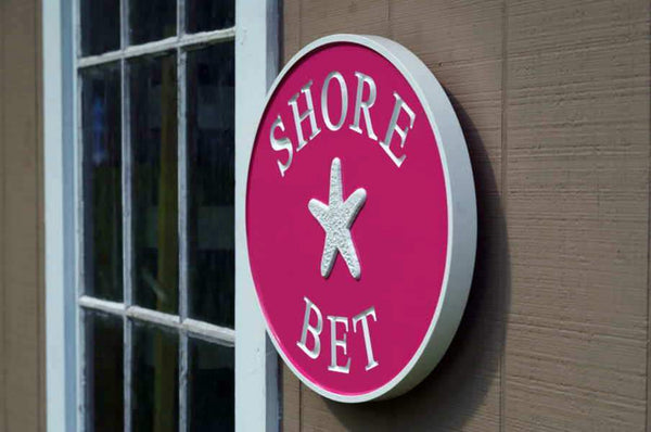 Shore Bet pink house name sign with starfish