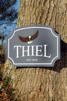 Thiel family name sign with flying eagle front view