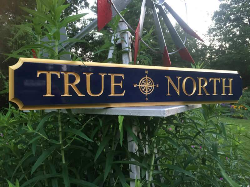 Custom Carved Quarterboard sign with Compass Rose image - Add your name (Q51) - The Carving Company  true north on wagon wheel left side view