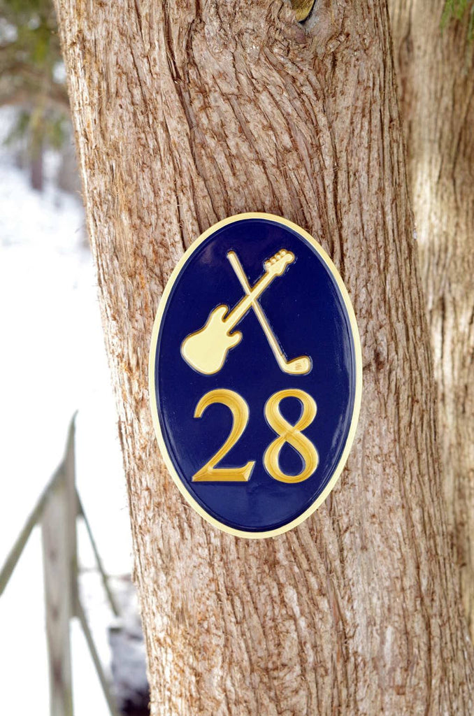 Custom carved house number sign with electric guitar and golf club