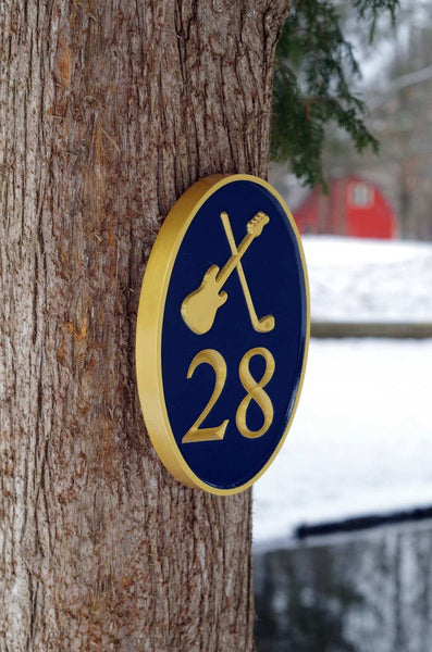 Custom carved house number sign with electric guitar and golf club painted blue and gold