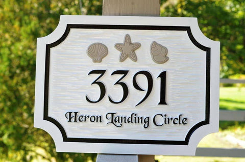 Custom carved address sign with sea shells