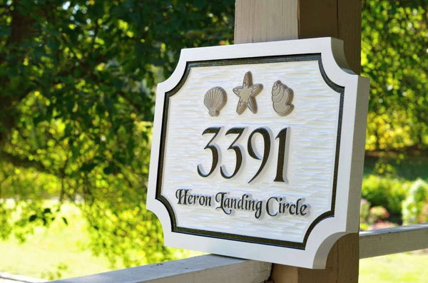 Side view of Custom carved address sign with sea shells