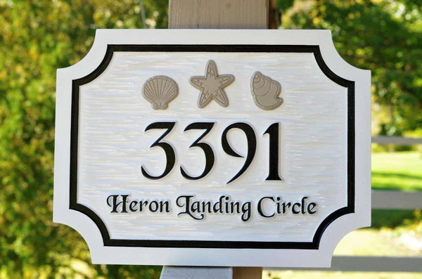 Custom carved address sign with sea shells painted white with black and taupe trim