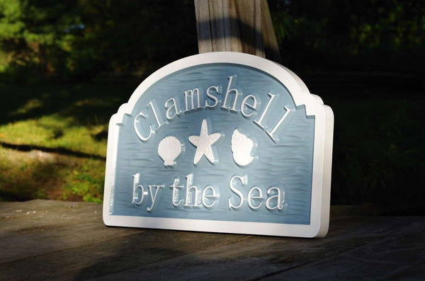 Custom carved beach address sign with Clamshell name carved on it