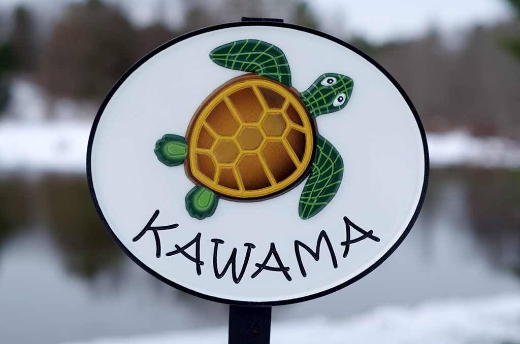 Kawama family name sign oval shape with turtle painted on it