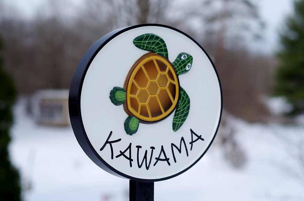 Kawama family name sign oval shape with turtle painted on it at an angle