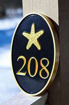 Oval house number sign with starfish as seen in HDTV magazine