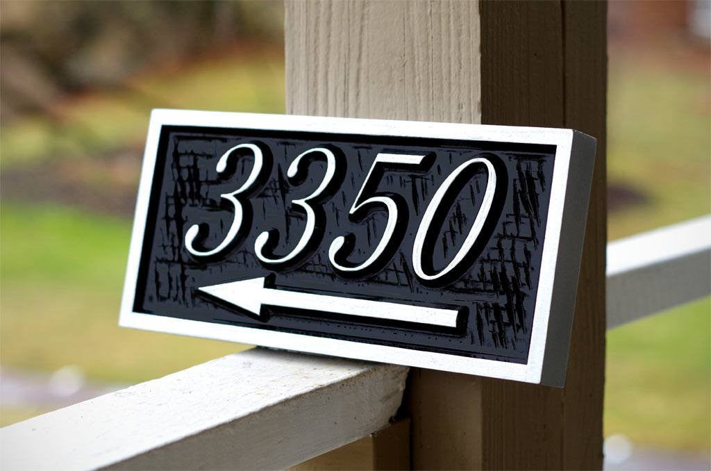 3350 number sign with arrow pointing right painted black and silver