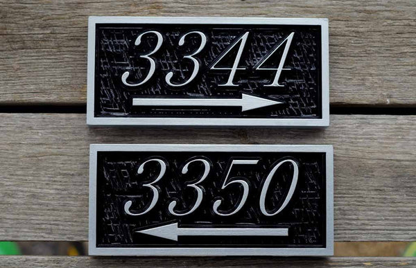 3344 and 3350 number sign with arrow pointing left and right painted black and silver
