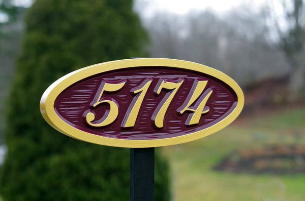 5174 oval sign on post painted cranberry and gold side ways view