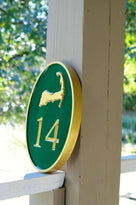 Any color Carved House number with gold cape cod on green background iso view