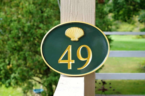 oval house number with small sea shell