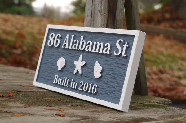Coastal address sign with sea shells