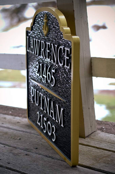 Double named house number sign in navy, white and gold with anchor side view
