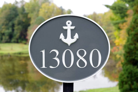 Nautical themed house number sign with anchor and 13080 painted gray and white