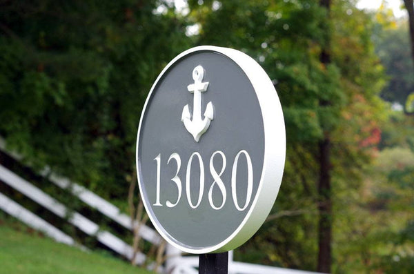 side view of Nautical themed house number sign with anchor and 13080 painted gray and white