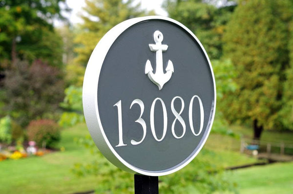 Custom carved address number with anchor and 13080 painted gray and white