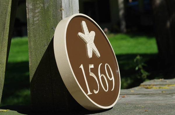 side view of Nautical themed house number sign with starfish and 1569 painted brown and cream