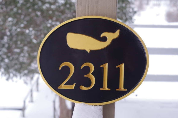 Custom carved oval house number with whale image