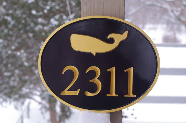 Custom carved oval house number with whale image painted black and gold