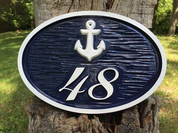 Custom carved house number address sign turned horizontal with an ancor and 48 oval shape painted blue and white