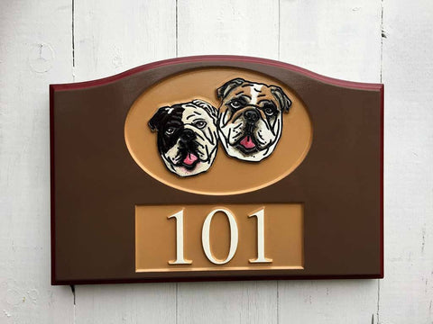bulldogs on brown toned address sign numbered 101 close up