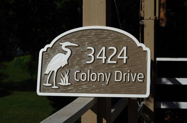 Custom carved brown address sign with heron