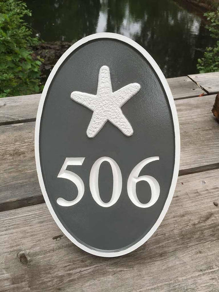 Custom carved oval address sign with starfish painted gray and white