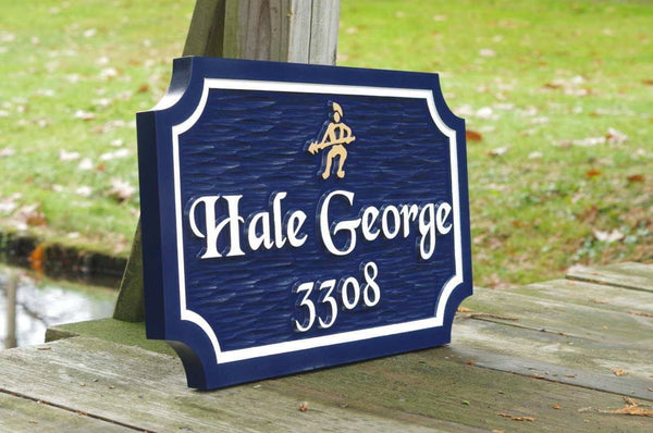 Angled view of Custom carved house name sign with house number and warriar image carved on it