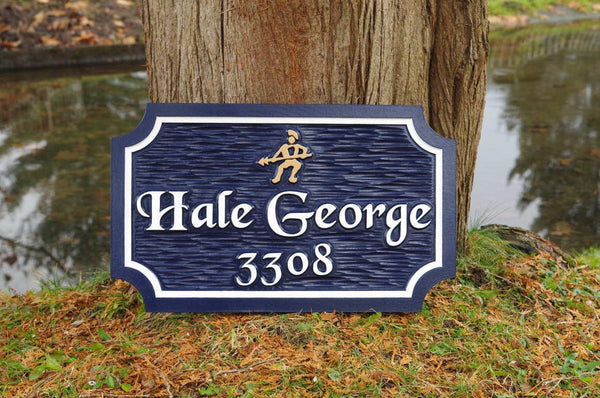 Custom carved house name sign with house number and warriar image carved on it painted navy blue and white