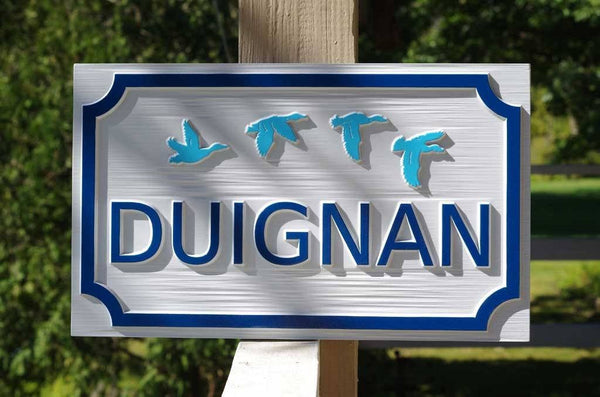 Custom carved family name sign with ducks painted white and blue