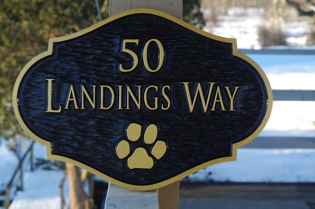 Custom carved address sign with paw print