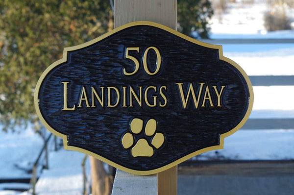 Custom carved address sign with paw print in ornate shape