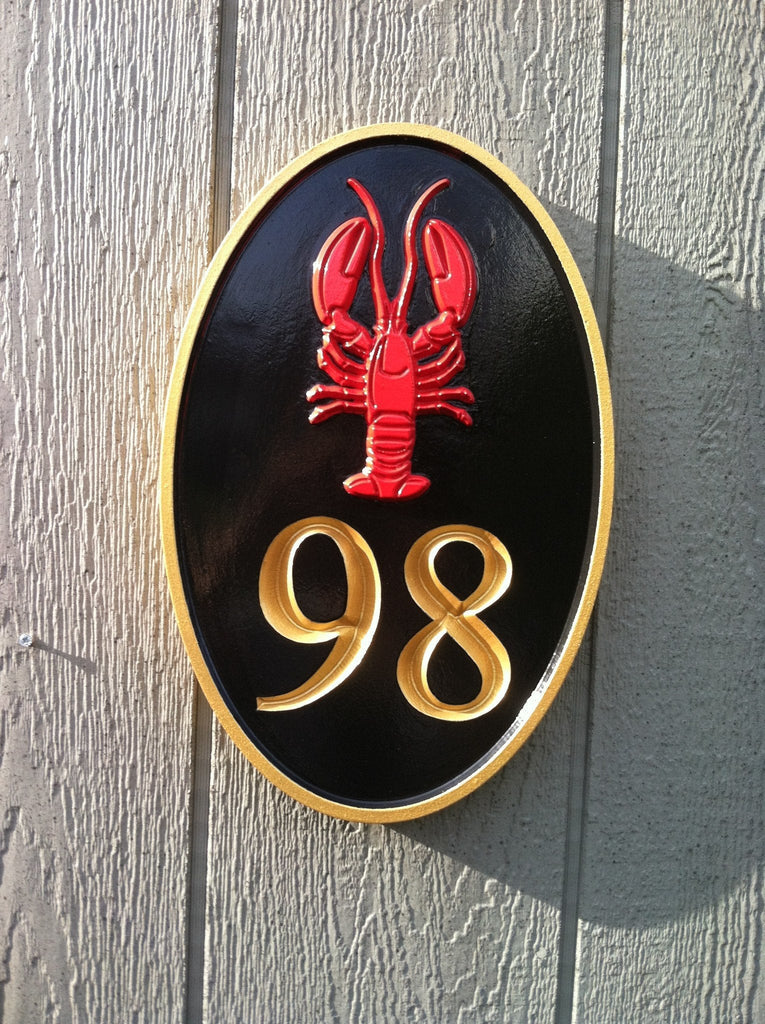 Oval house number sign with lobster