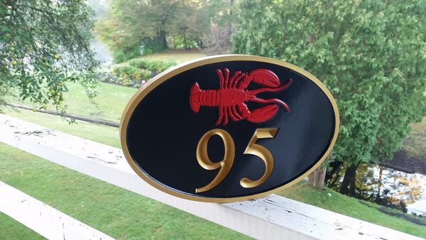 Oval house number sign with lobster horizontal