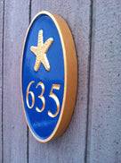 Any color Carved House number with blue and gold starfish iso view