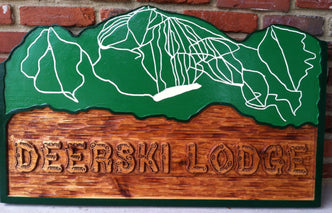 Cedar lodge sign with mountain ski map