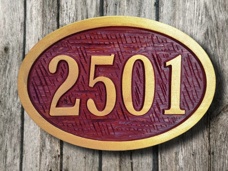 Oval cedar house number with textured background -front
