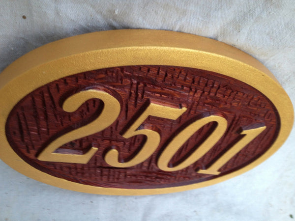 Oval cedar house number with textured background -iso