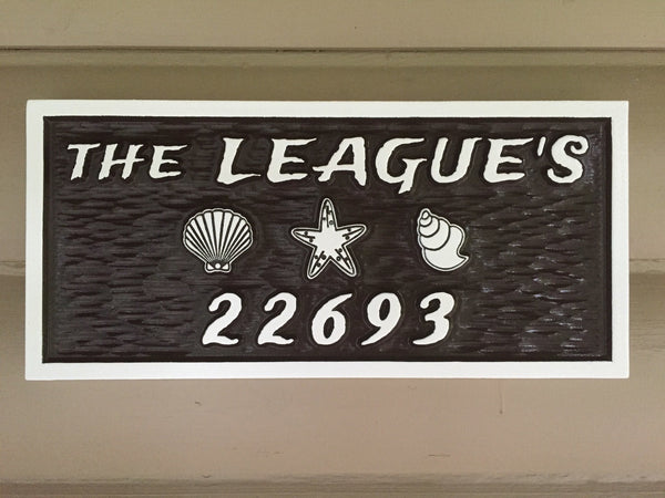 Leagues name and house number sign with beach theme