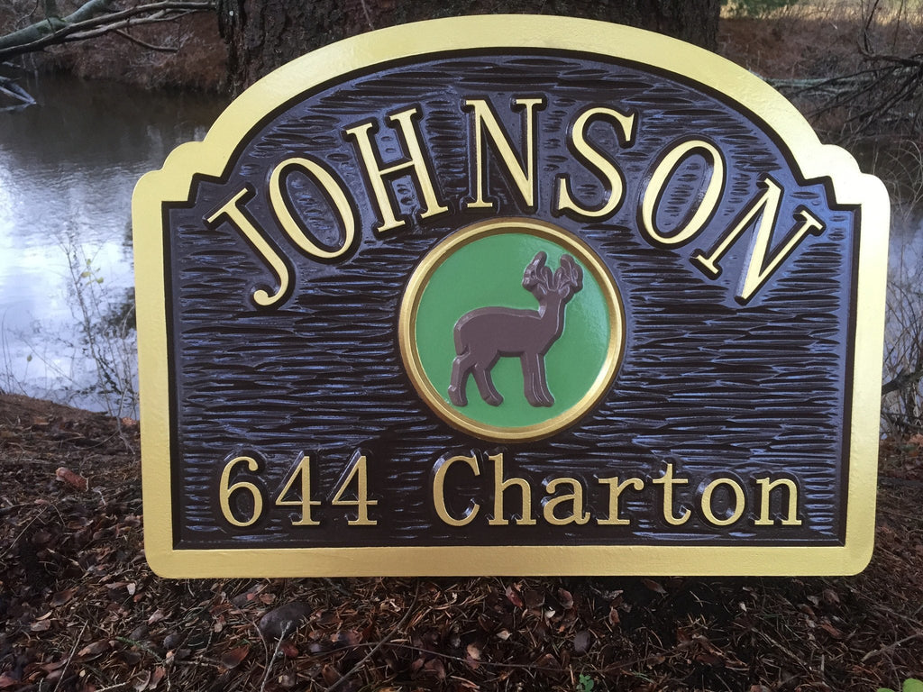 Last name sign with address and deer image