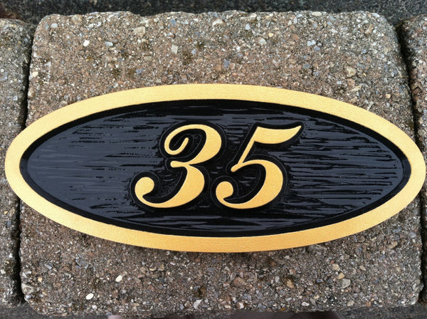 Oval house number sign with textured background -35