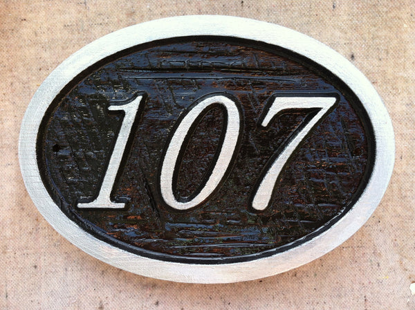Oval house number sign with cross hatch textured background -front3