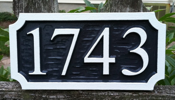 four digit House number sign with textured background -front