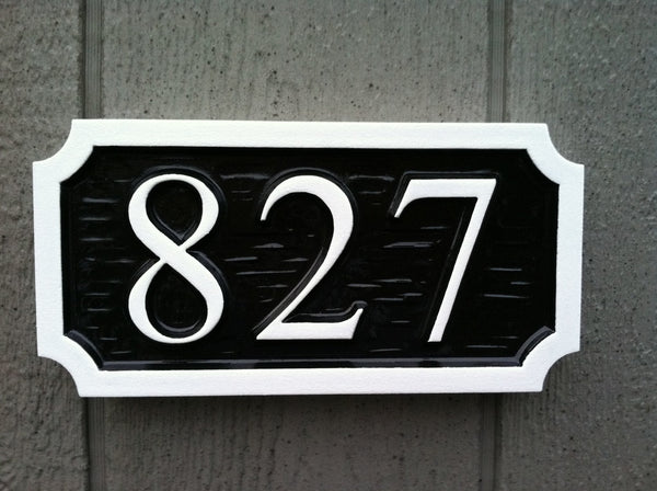 House number sign with textured background -front2