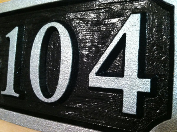 House number sign with textured background -iso