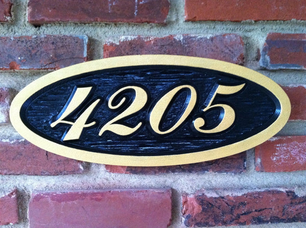 Oval house number sign with fancy font
